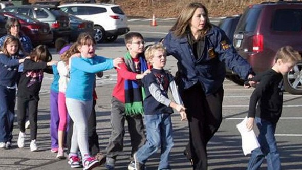Police lead children from the Sandy Hook Elementary School in Newtown, Conn., following a reported shooting there Friday, Dec. 14, 2012.  (AP Photo/Newtown Bee, Shannon Hicks)